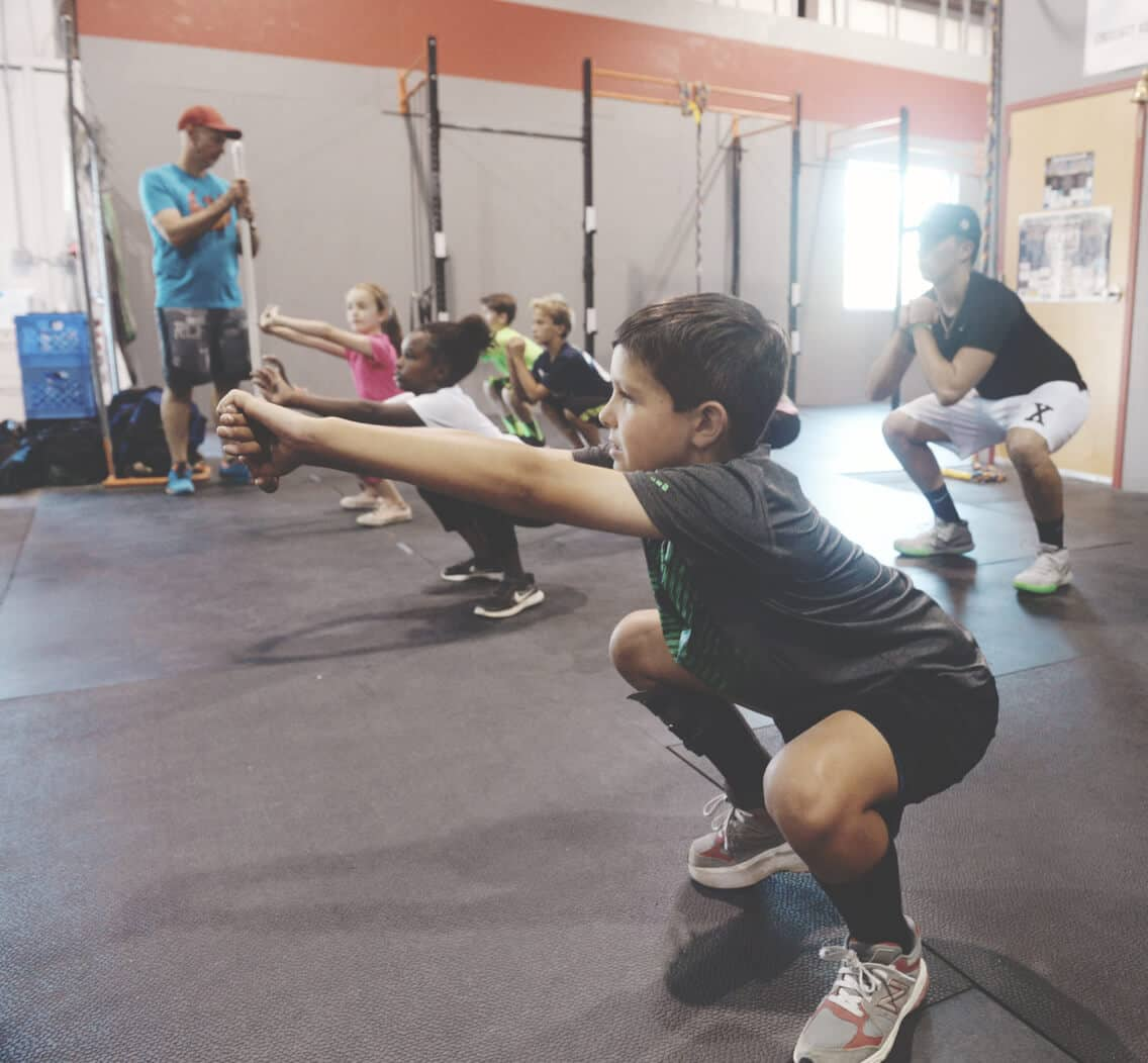 An image used for the custom Firehawks CrossFit Kids & Teens website of children warming up for exercise